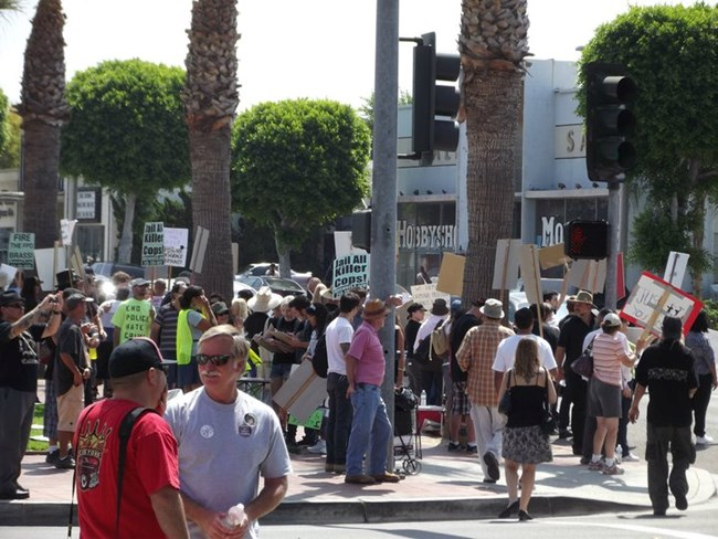 Protests form outside the police dept.